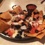 $11 nachos. . we added beef for $3. . got about 1/2 a cup of it. . worst nachos ever