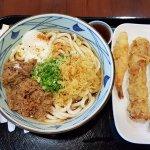 Nikutama Udon and prawn, fish cake, asparagus, and squid tempura