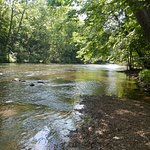 The hiking trail from the covered bridge to the Pleasant Hill Dam follows this river.