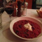 A plate of risotto and a glass of red wine made a lovely dinner for one.