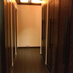 Passage between room and bathing area. The large cupboards are on the right. Bathing area to lef
