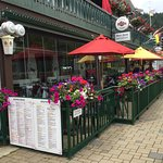 An early-morning patio view - lovely flower baskets, menus, etc.