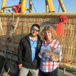 Owner of Voyager Balloons presents flight certificate and bubbly