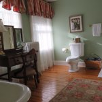Wible Suite: large bathroom with vanity, clawfoot tub, and shower