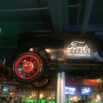 This old Ford mounted above the bar has wheels that turn all day and night