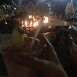 Outdoor fire pit and a beachy mixed drink from the hotel bar.