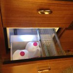 refrigerator was inside a drawer. Can fit two one gallon milk containers with ease.