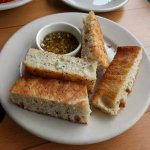 Focaccia bread and garlic dipping oil.