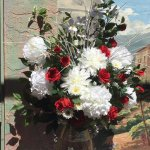 Our Flowers in front of mural, we used silk flowers, hot day but patio is shaded