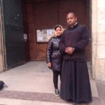 Dimin and the priest  in Paris.
