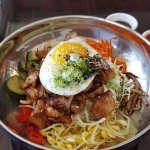 bibimbap (Chicken on rice with stir-fried veggies and topped with a sunny side up egg).