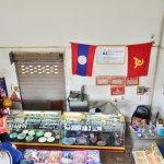Souvenir shop displays Communist flag and photos of totalitarian leadership