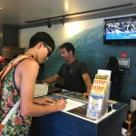 Signing his life away... Thanks to the guy behind the counter, he helped set up this dream surfi