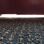 Gap under balcony door. All that air conditioning just escaping and street noise coming in.