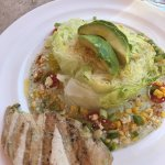 Wedge salad with grilled chicken added to it
