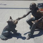 The girl with her dog statue