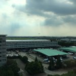 Views from my room 817 towards the terminals and runway and the very important shuttle timetable