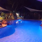Relaxing by the pool at Vatu Sanctuary, Alice Springs