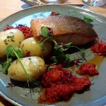 Pan fried salmon with olive and tomato sauce