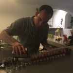 Bartender extraordinaire Spyros pouring homemade shots for everyone in the bar