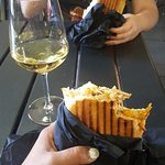 Me and my friend enjoying the chicken panini along with a class of wine (appx 11:45 am)