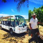 Mike Naggiar giving a tour of the vineyard with the eco Shuttle