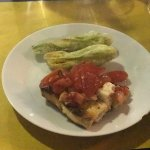 Lightly fried fresh zucchini flowers with tomato bruschetta. Amazing Fresh black truffle steak o