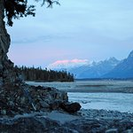 Day 1 camp with view of Chitina River and Mt Logan in Canada with alpenglow.