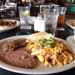 Migas with fresh-made sausage patties. Eggs, bacon and French Toast in the back..