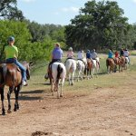 Trail ride departs on the Mayan Ranch