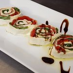 House made mozzarella stuffed with basil and prosciutto with a balsamic glaze