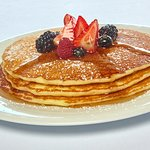 The pancake trio stack, with a variety of syrups to satisfy all tastes.