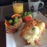 Croissant Benny served with fresh fruit