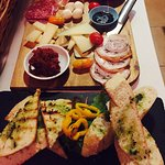 Homemade bread, Italian cheese and cured meat platters