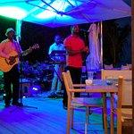 Omalie 360 singing at the restaurant