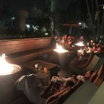 Fire pits & tables adjacent to pool area
