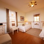 The Ivory Rose Room with extra long twin beds and a roof garden!