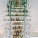 The 'tree' is made from glass tumblers of various colours