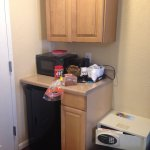Mini fridge area, top cabinet opens (empty), bottom cabinet and drawer are decorative