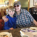 Grandma and Grandpa took two grandsons for breakfast.