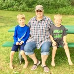 Grandsons rest in the playground park with Grandma.