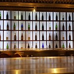 wall decoration of different bottles of alcohol