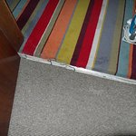Room carpet completely free of door bar.