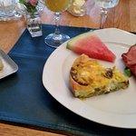 Frittata, ham, melon and bread