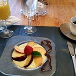 Nectarines, and strawberry in a custard sauce
