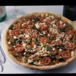 Mediterranean pizza on our handmade semolina crust. All pizzas are baked in our wood-burning ove