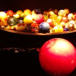 Giant glass balls in a giant bowl. Marbles of all colors.