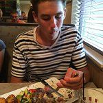 Grandson trying to chew really tough ribeye, not good!