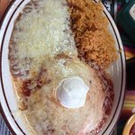 Huevos Rancheros: Two eggs over-easy and topped with ranchero sauce, melted cheese and sour crea