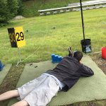 Looking downrange to try to hit a target at the biathlete shooting